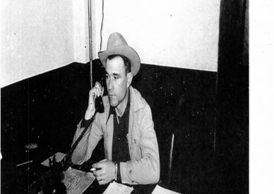 Former Sheriff Amos G Ward taking a call